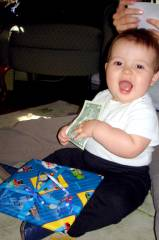 Josiah and his first first birthday dollar