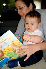 Josiah reading his first first birthday book