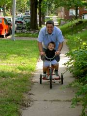 Josiah & Dad riding the trike